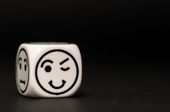 Single emoticon dice with blinking expression sketch Stock Photography