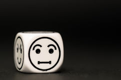 Single emoticon dice with confused expression sketch Royalty Free Stock Image