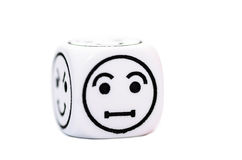 Single emoticon dice with confused expression sketch Stock Image