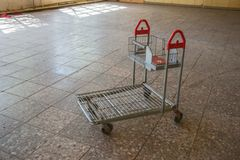 Single empty shopping cart. In the abandoned building Stock Images