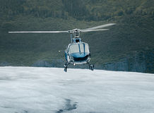 Single-engine helicopter landing on an ice field Stock Photography
