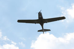 Single-engine light aircraft flying in the sky Stock Photos