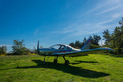 A single-engine plane on a small field, Abkhazia. Stock Images