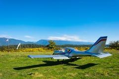 A single-engine plane on a small field, Abkhazia. Stock Photo