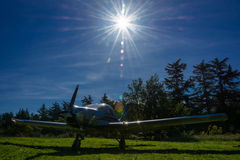 A single-engine plane on a small field, Abkhazia. Stock Photos