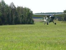 Single engine plane taxies on grassy field
