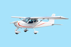 Single engine small white airplane isolated. Single engine small white airplane with red line isolated Stock Photos