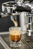 Single Espresso shot brewed in a shot glass Royalty Free Stock Image