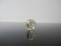 Single Euro coins on grey background Royalty Free Stock Photography