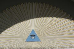 Single eye in blue triangle. As an ornament above a door Royalty Free Stock Photography
