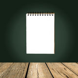 Single face notebook on greenboard Stock Photo