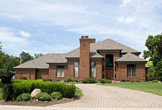 Single Family Brick Home. Single family red brick home with cobblestone driveway Stock Photography