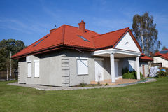 Single family grey house. Single family house in grey color against blue sky Stock Images