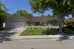 Single Family Home With a Picket Fence Stock Images