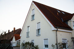 Single family house in Munich, blue sky, white facade. Housing Royalty Free Stock Image