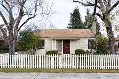 Single family house one story with picket fence Stock Photo