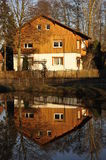 Single Family House Reflection. Reflection of a rural single-family house in the village's fire water pond near Erlangen, Bavaria, South-Germany Royalty Free Stock Images