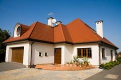 Single family medium house. Single family white medium house over blue sky Royalty Free Stock Photography