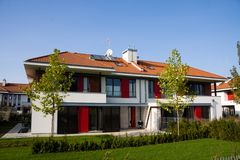 Single family medium house. Single family white medium house over blue sky Stock Photo