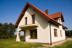 Single family small house. Single family bright house over blue sky Stock Photo