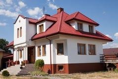 Single family yellow house. Over blue sky Royalty Free Stock Photos