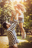 Single father on meadow with his daughter. royalty free stock images