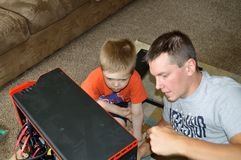 Single Father and Son Fixing Computer stock photo