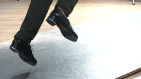 Single female tap dancer wearing pants showing various steps in studio with reflective floor. Single female tap dancer wearing six pockets pants showing various Royalty Free Stock Photo