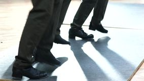 Single female tap dancer wearing pants showing various steps in studio with reflective floor. Single female tap dancer wearing six pockets pants showing various Royalty Free Stock Image