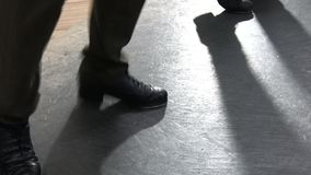 Single female tap dancer wearing pants showing various steps in studio with reflective floor. Single female tap dancer wearing six pockets pants showing various Stock Photos