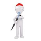 Single figure in Santa hat holding umbrella Stock Photography
