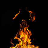 Single fire flame on black background. In high resolution Stock Photo