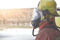Single fireman in fire fighting protection suit Stock Image