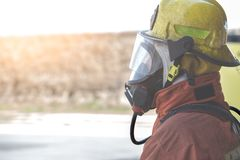 Single fireman in fire fighting protection suit Royalty Free Stock Photos