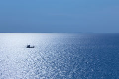 Free Single Fishing Boat In The Ocean Stock Photos - 79623783
