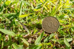 Rupiah coin money on green grass. Single five hundred Indonesia Rupiah coin money on green grass Royalty Free Stock Images