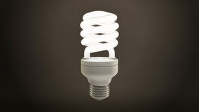 Single Fluorescent Light Bulb Over Dark Background Royalty Free Stock Photos