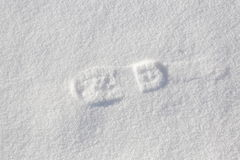 Single foot step on snow. Royalty Free Stock Photo