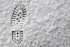 Single footprint in snow Stock Photo