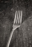 Single fork on old wooden plank Stock Photo