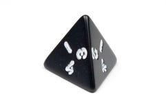A single four-sided die (tetrahedron). Macro photo of a single, black, four-sided die (tetrahedron), on white background Stock Photo