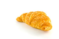 Single fresh croissant, casting soft shadow. Stock Images