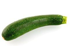 Single fresh zucchini. Isolated on white background royalty free stock image