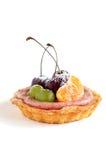 Single fruit mini tart on white Royalty Free Stock Image