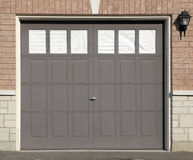 Single Garage. Door on a brick house Stock Photos