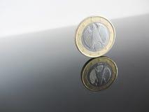 Single German Euro coins on grey background Stock Photos