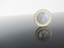 Single German Euro coins on grey background Stock Images