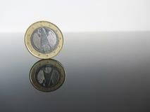 Single German Euro coins on grey background Royalty Free Stock Photos