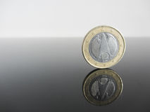 Single German Euro coins on grey background Royalty Free Stock Photography