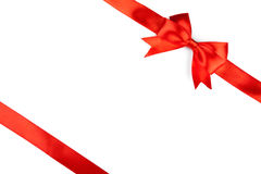 Single gift bow, red satin, with cross ribbons Royalty Free Stock Images